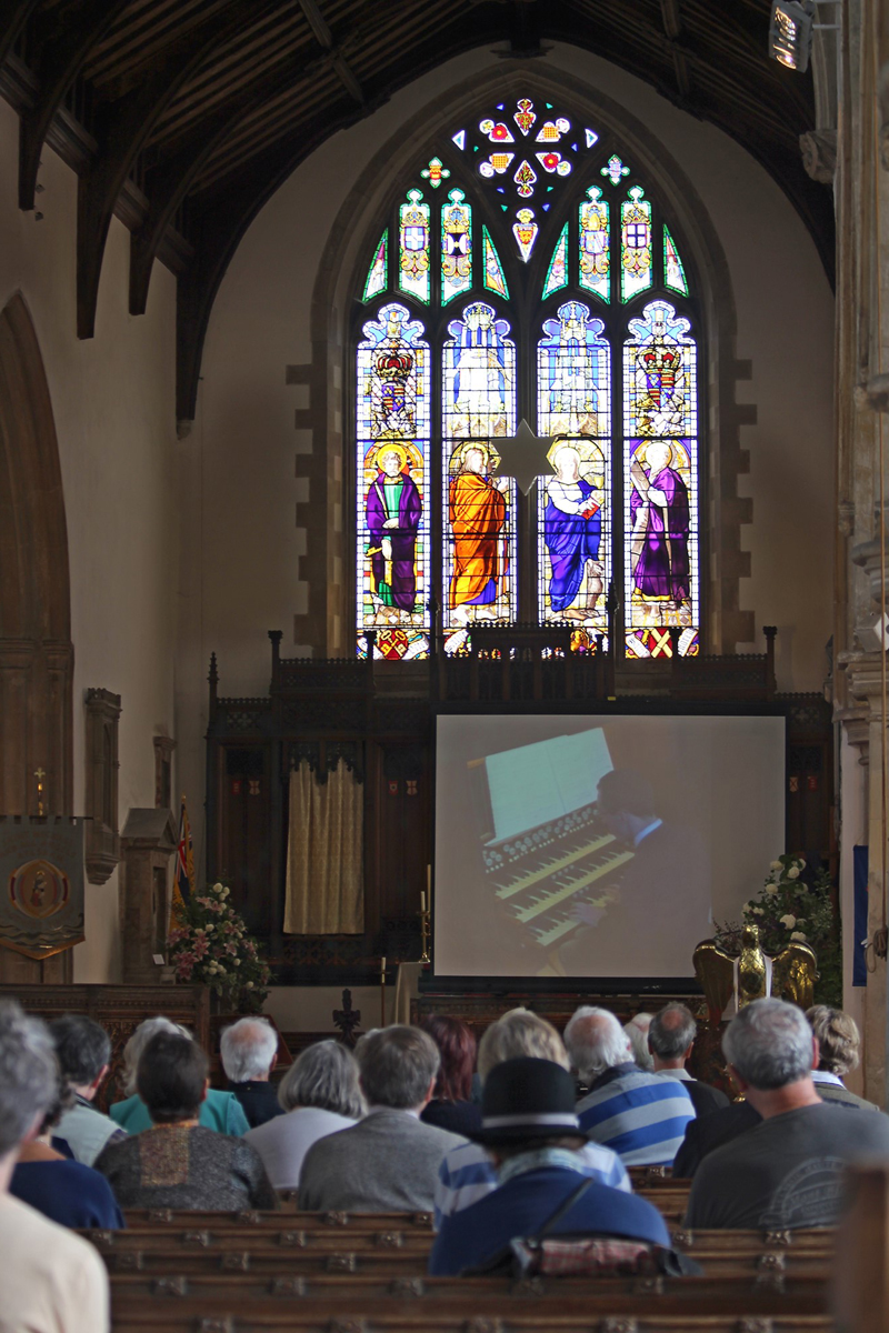 East window and organ on screen
